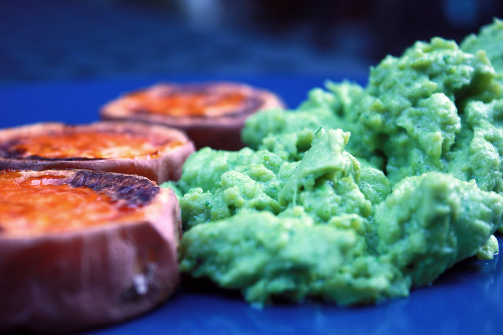 green scrambled eggs on a plate with discs of roasted sweet potato