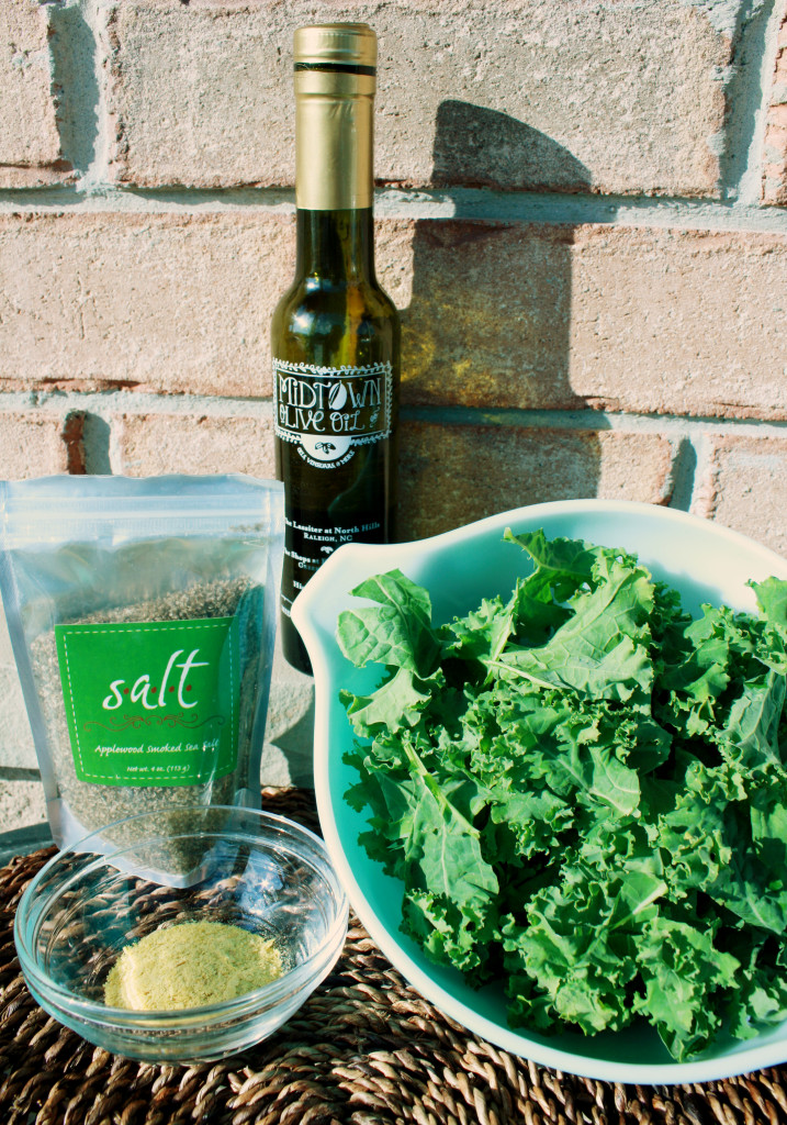 All the ingredients I used for these kale chips: basil-infused olive oil, applewood smoked sea salt, nutritional yeast, and a head of kale torn into bite-sized pieces