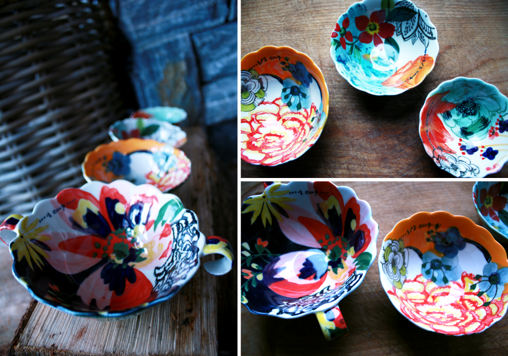 decorative Anthropologie measuring cups arranged in a line on a firelog