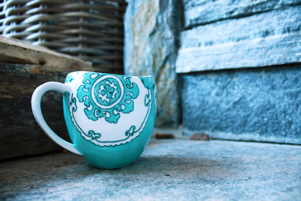 Anthropologie mug in front of the cottage fireplace