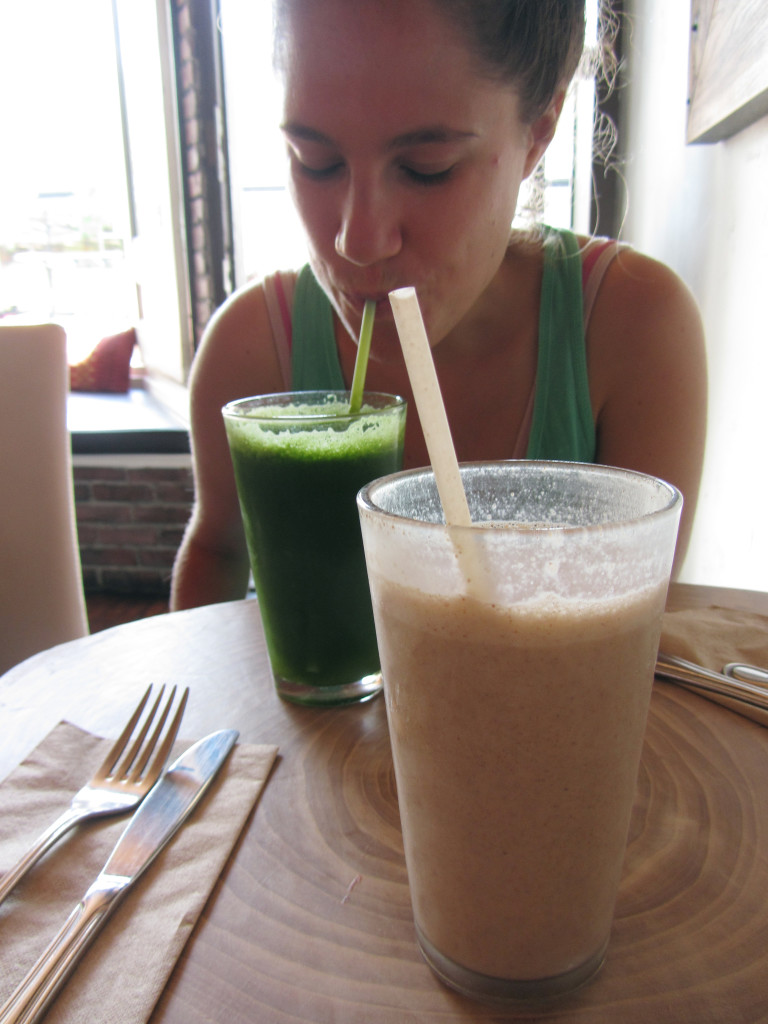 Another shot of my smoothie with my friend, Saar, sipping on green juice (kale, celery, cucumber, romaine lettuce, parsley, lemon and ginger) in the background