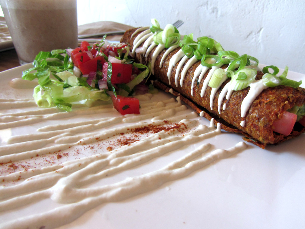 Another shot of my raw vegan burrito, slathered in cashew cream and garnished with a side salad
