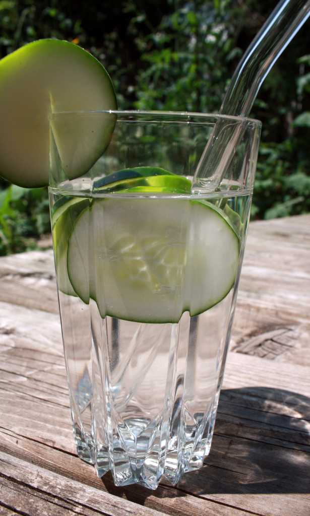 A nice tall glass of cucumber water, garnished with a cucumber slice, featuring my glass straw