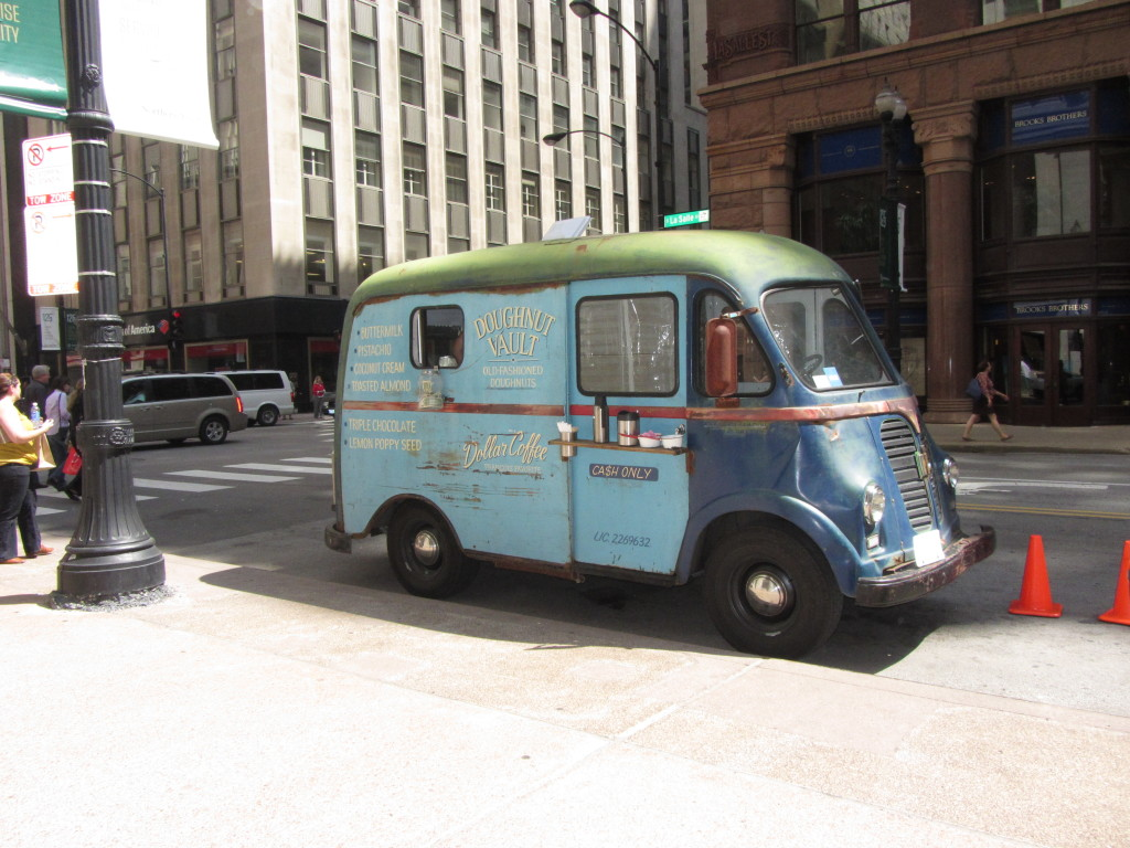 An adorable little vintage-looking van. It sold doughnuts!