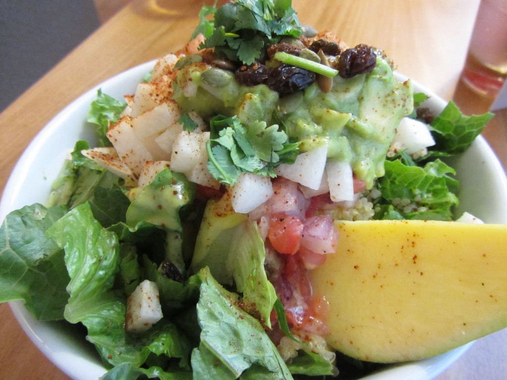 Fresh avocado, jicama and cucumber salsa atop quinoa, romaine and our award winning mango-lime vinaigrette. Topped with currants, toasted pumpkin seeds and cilantro