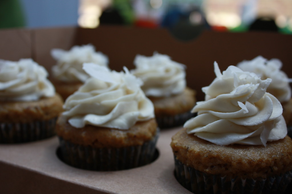 Tasty looking cupcakes. Looks like vanilla frosting!