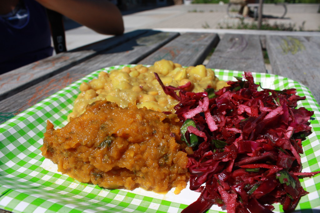 My lunch! A curry platter featuring a split pea curry, a sweet potato curry, and a red cabbage slaw. Yum....