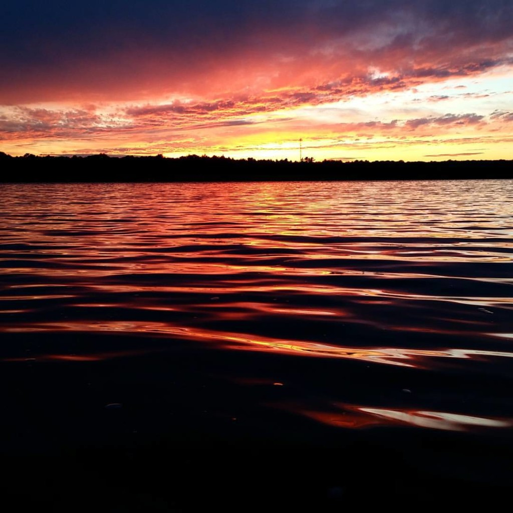 vibrant sunset over a lake in Northern Ontario