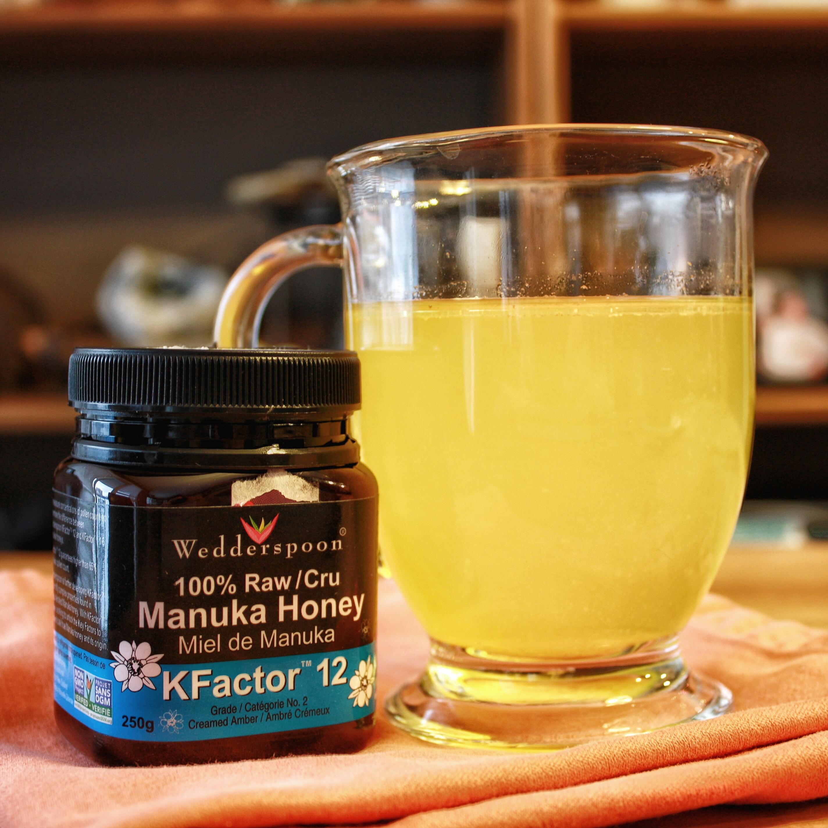 a hot mug of immunity elixir and manuka honey